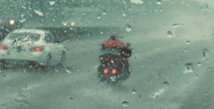 ProBEAM Motorcycle LEDs visible in the rain.